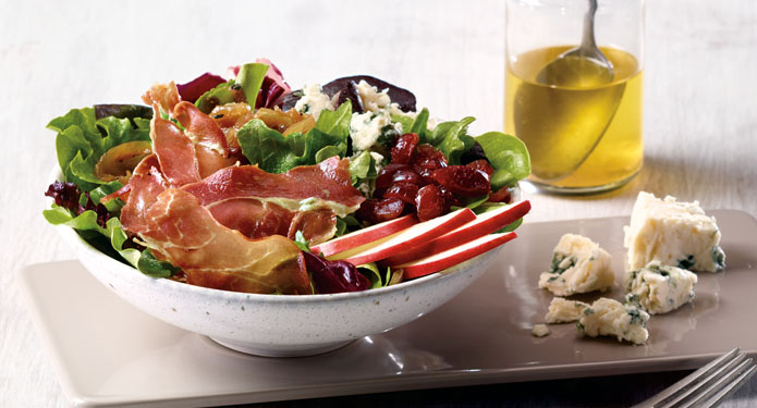 prosciutto salad on a plate with blue cheese