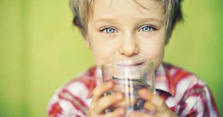 Kid with glass of water