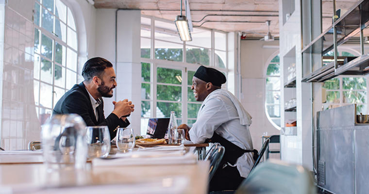 Boss at a table coaching his chef