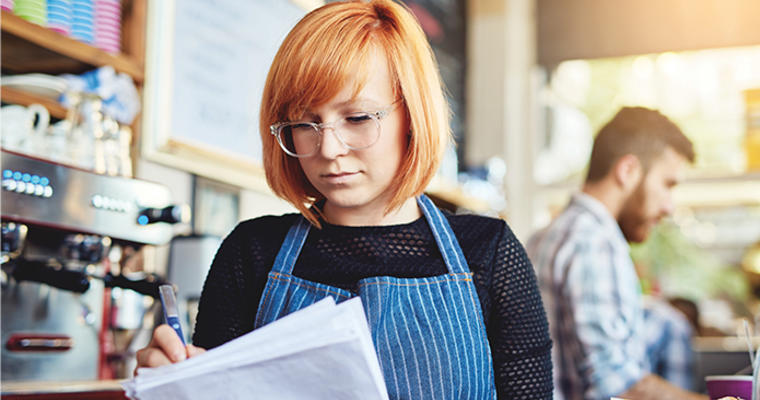 A restaurant worker looks at her upcoming schedule