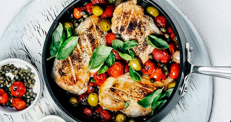 Chicken and vegetables in a skillet