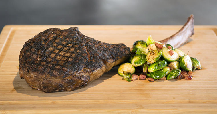 USDA Prime-Tomahawk with Cajun Bacon Brussels Sprouts