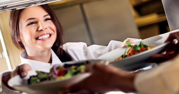 Server happily taking food tray