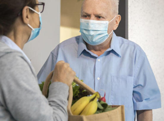senior food delivery with mask