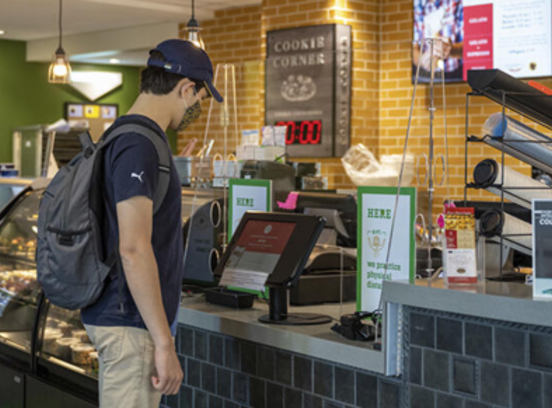 student ordering on campus with touch-screen