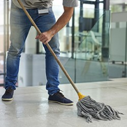 Custodian mopping floor