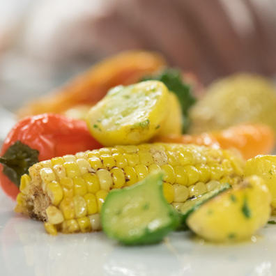 Cooked corn, peppers, and squash
