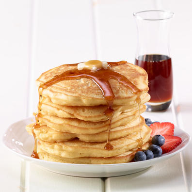 Buttermilk pancake stack with syrup and fruit