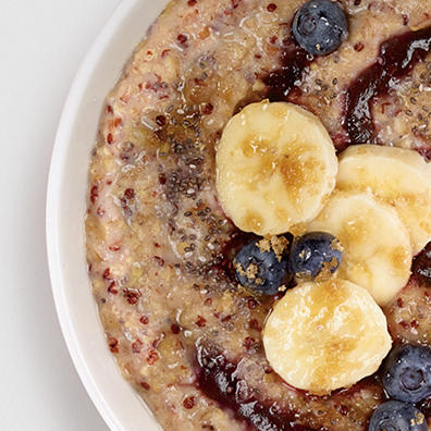 Grain oatmeal with brown sugar, bananas, and blueberries